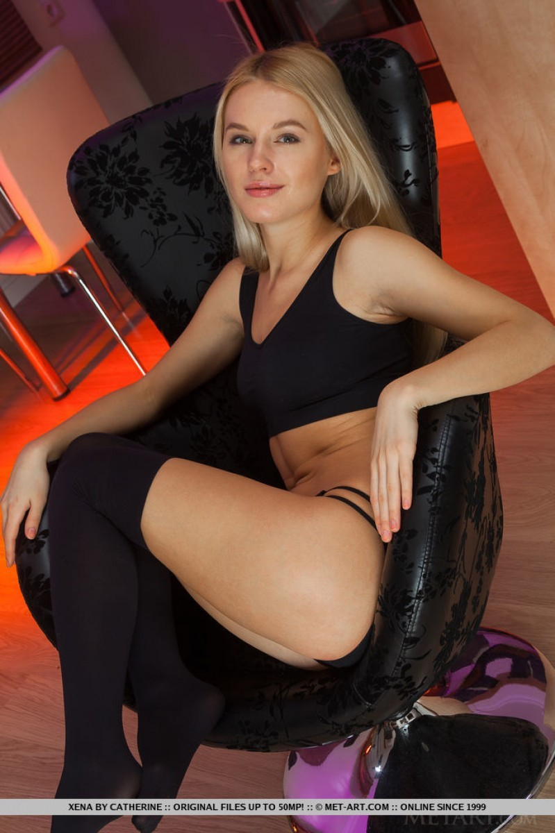 Blonde naked on lounge chair