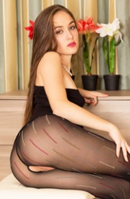 Leggy Brunette in Ripped Pantyhose
