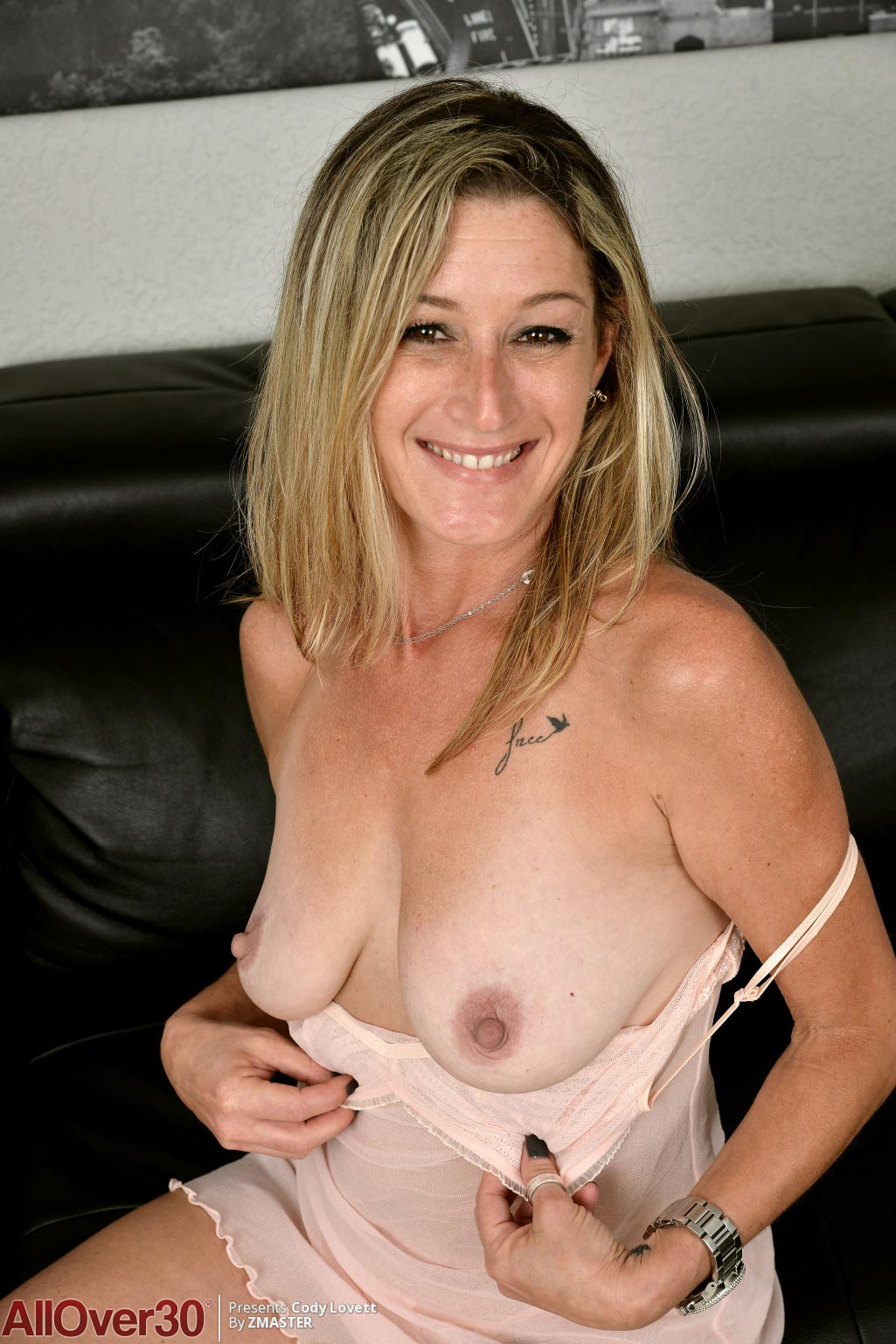 Busty milf strips and fucks young lad 8