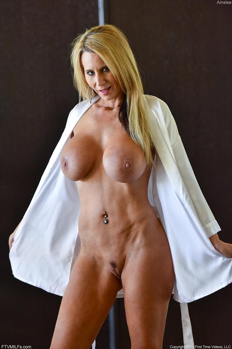 Voyeur photos of sexy young women topless on beach