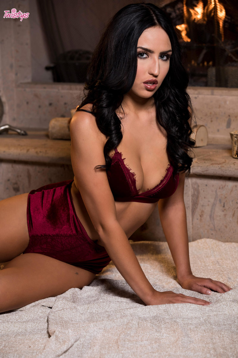 jade baker strips by the fireplace