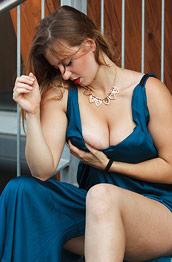 Busty Sera Rossini in a Sexy Dress